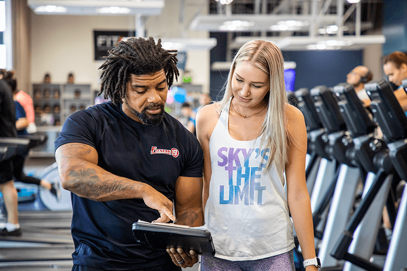 Personal Trainer and client discussing a workout program